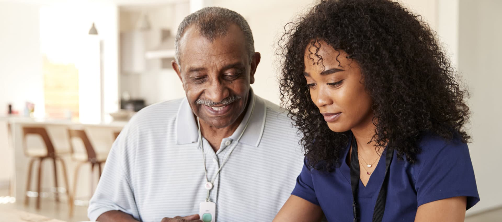 young african female caregiver and her old man patient