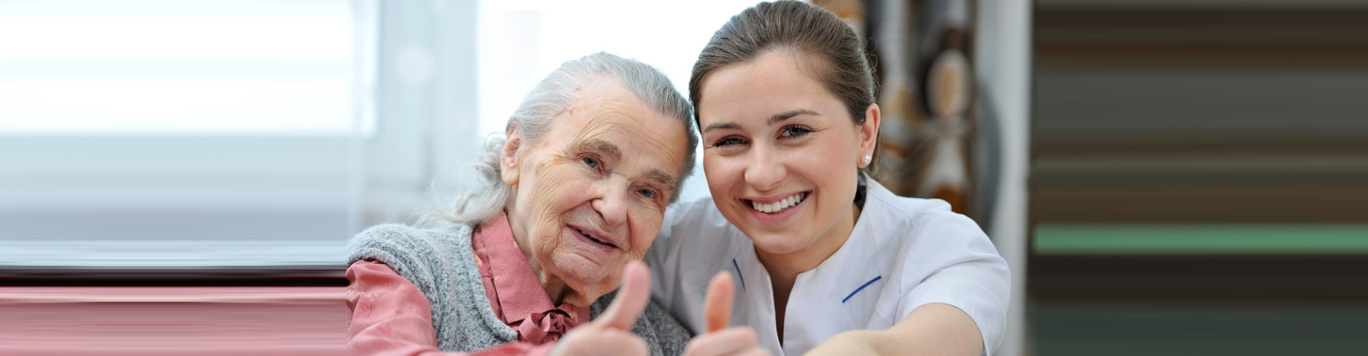 female caregiver and her old woman doing thumbs up